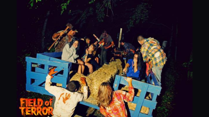 Haunted hayride with scared passengers.